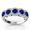 Fancy micro pave set wedding anniversary band with blue sapphires