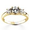 Yellow gold pre set three stone engagement ring
